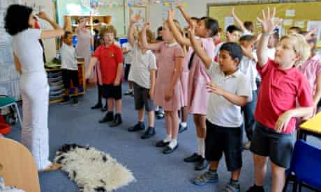 Pupils sing and dance as they learn Italian at Springfield Lower School, Kempston, Bedfordshire