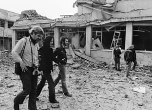 Joan Baez and other anti-war activists walk through the ruins of Galem International Airport in Hanoi, Vietnam