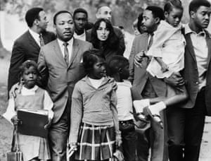 Martin Luther King, Jr. and Baez lead a group of children to their newly integrated school in Grenada, Mississippi in September 1966