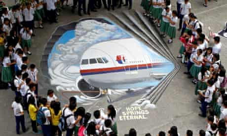 Pupils in Manila view a tribute to the Malaysia Airlines flight