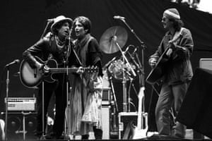 Baez appearing on stage with Bob Dylan and Carlos Santana in 1984