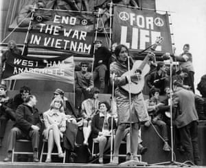 Joan Baez plays in Trafalgar Square, during a protest organised against the war in Vietnam in 1965