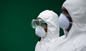 Health workers conduct an Ebola prevention drill at the port in Monrovia, Liberia.