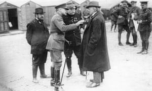 French commander Joseph Joffre, centre, talks to David Lloyd George and Sir Douglas Haig