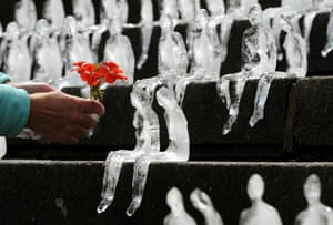 Figures made out of ice forming the Minimum Monument by Brazilian artist Nele Azevedo