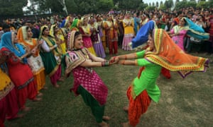 Women sing folk songs and perform a folk dance from the Punjab during the Teej festival in Amritsar