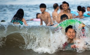 Children play on the beach in Xiangshan on the East China Sea
