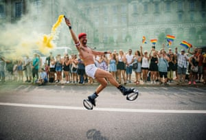 A participant dances during the gay pride parade in Stockholm.