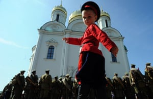 A boy takes part in a ceremony commemorating the 100th anniversary of the first world war in Tsarskoye Selo