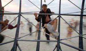 A participant climbs onto the Eidolon Panspermia Ostentatia Duodenum (EPOD) spinning art installation