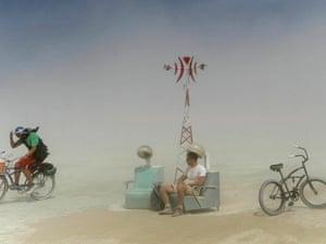 Revellers endure a dust storm.
