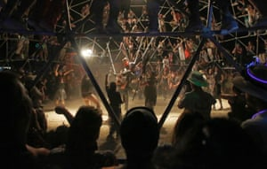 A crowd watches as two fighters battle in the Thunderdome.