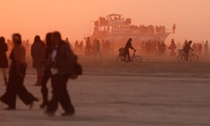 Mutant vehicles and participants make their way across the Playa.