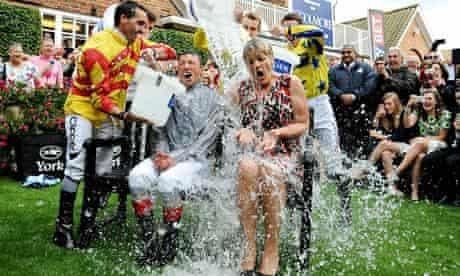 Jockey Frankie Dettori and television presenter Clare Balding take part in the ice bucket challenge
