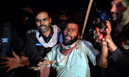 Protests Islamabad arrest injured man