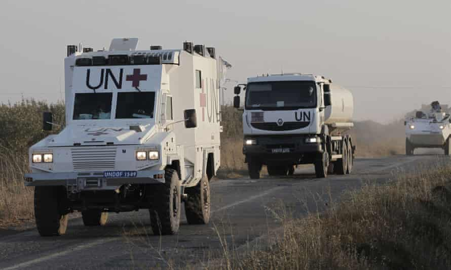 Members of the United Nations force are evacuated after the fighting.