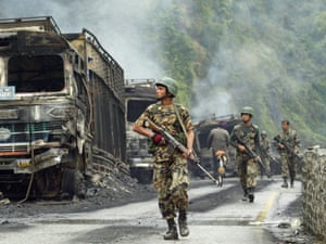 Nepalese soldiers patrol during the civil war in 2005.
