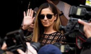 Photographers and video journalists capture the arrival of British singer Cheryl Cole