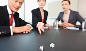 Business people throwing dice on conference room table.
