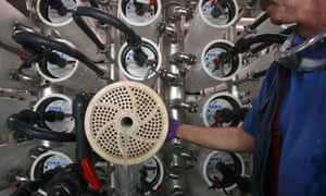 Senior Plant Operator waits as water is used to push a membrane out from a pressure vessel in the Reverse Osmosis facility, which is part of the Groundwater Replenishing System in Orange County Water District, in Fountain Valley, California. The Reverse Osmosis System removes salts, viruses and pharmaceuticals from the water.