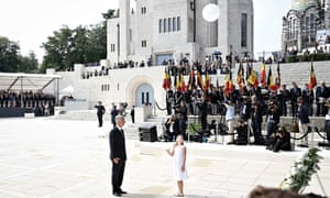 King Philippe watches a girl release a 'peace' balloon at a first world war ceremony in Liege