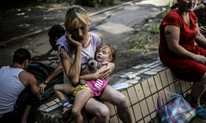 Refugees wait in front of a hostel run by pro-Russian rebels in Donetsk, on August 4, 2014. Fighting between government forces and pro-Russian rebels left at least 10 civilians dead in eastern Ukraine on Sunday.