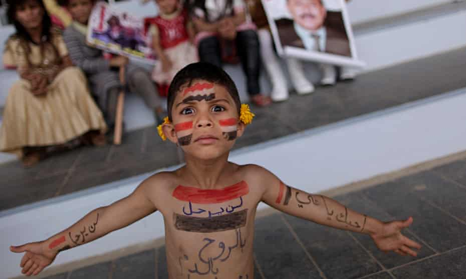 A Yemeni boy painted with the colours of his national flag.
