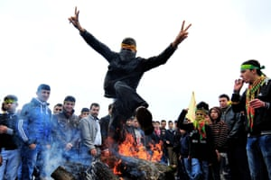 A Turkish Kurd jumps over a fire during a gathering to celebrate Noruz, the Kurdish New Year, in Istanbul in 2011.