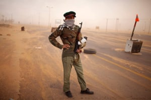 A rebel soldier at a check point on the outskirts of Benghazi, Libya.
