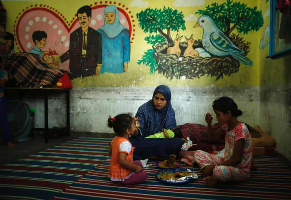 A Palestinian woman and two girls, at a United Nations-run school in Gaza, July, 2014.