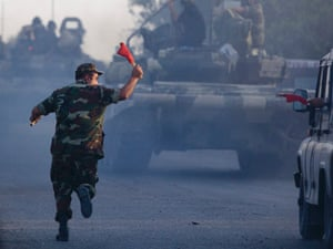 A convoy of Azeri army tanks moves in the direction of Agdam, Azerbaijan, on 2 August. Recent days have seen a sharp escalation in fighting between Azerbaijan and Armenia a tense line of control around Nagorno-Karabakh. (AP Photo/Abbas Atilay)