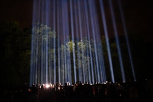 "People enjoy an artwork entitled ""Spectra"" by Japanese visual artist Ryoji Ikeda during ""Lights Out"" in London"