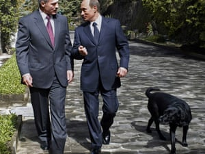 Russian President Vladimir Putin, right, speaks with his Belarus counterpart Alexander Lukashenko as they walk with Putins' Labrador, Koney, during their meeting at Putin's vacation residence in Sochi, Russia, a Black Sea resort, Monday, April 4, 2005. Lukashenko is on a visit to Russia. (AP Photo/ ITAR-TASS/ Presidential Press Service)