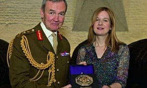 Holly Davies receives her British Empire Medal from Chief of the Defence Staff, Sir Nick Houghton