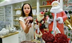 Staff at Selfridges in London, look at this year's Christmas shop