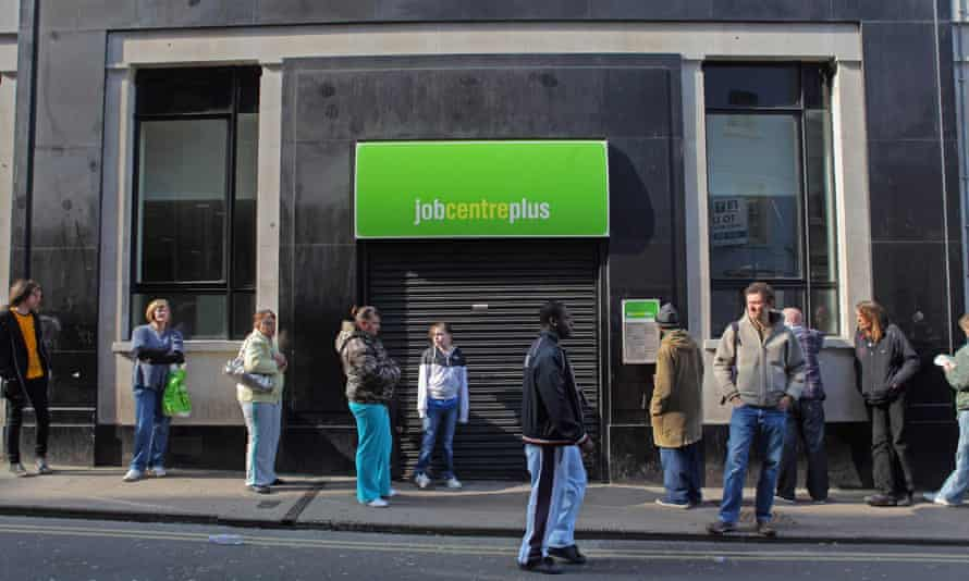 Jobseekers queue outside a jobcentre in Bristol.
