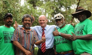Campbell Newman, as LNP leader in 2012, receives a t-shirt from a group of Aboriginal leaders, who were against Labor's Wild Rivers Legislation.