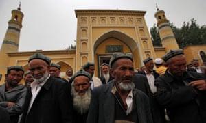 Uighur Muslim men outside a mosque in the Xinjiang region of China.