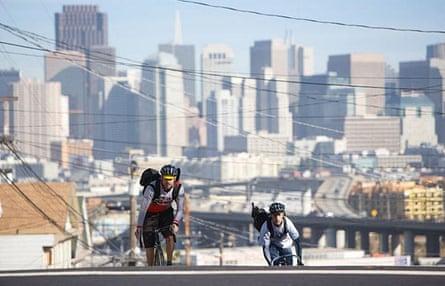 Two bike messengers ride in San Francisco.