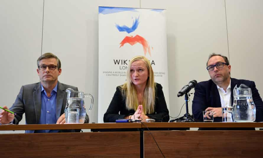 (L-R) General Counsel or the Wikimedia Foundation, Geoff Brigham; Wikimedia Foundation Chief Executive, Lila Tretikov and Wikipedia co-founder, Jimmy Wales, attend a press conference in central London on August 6, 2014 ahead of the Wikimania conference.