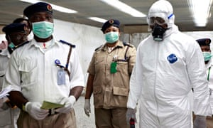 Nigerian health officials wait to screen passengers at Lagos airport