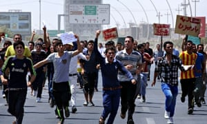 Yazidi members demonstrate outside UN offices in Erbil