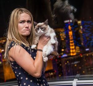 Grumpy Cat's owner Tabatha Bundesen mimics her pet's sour expression.
