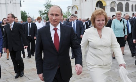 President Vladimir Putin (L) and his then wife Lyudmila in 2012.