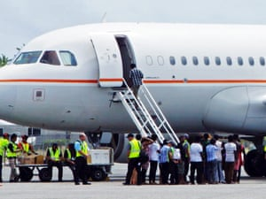 A group of Tamil asylum seekers board an airplane at Cocos Island.
