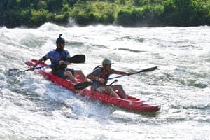 Sam Ward takes Lev kayaking down the white water rapids at the source of the Nile, Uganda.