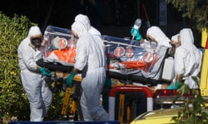 Health workers wheel a stretcher into a hospital with one of two Spaniards repatriated from Liberia, who has tested positive for the Ebola virus.
