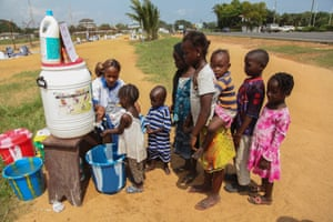 Children are encouraged to wash their hands in Monrovia, Liberia.