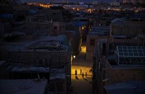 Children play in the street in old Kashgar.