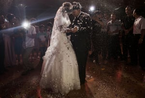 A couple have their first dance at their wedding celebrations.